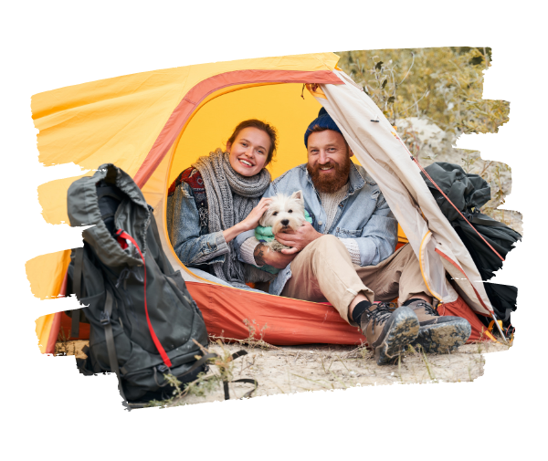 Couple in a tent with a dog